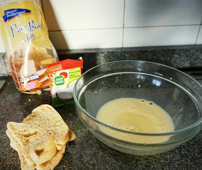Alcune morbide fette dipane senza glutine, una confezione di latte di cocco e una ciotola contenente l'uovo sbattuto: ecco tutto il necessario per la ricettadel French toast glutenfree.